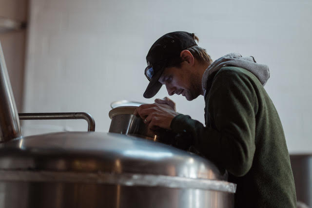 Head Brewer Jason looking in on one of the Tap Social brews.