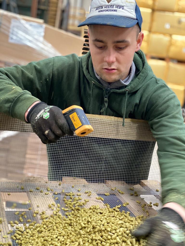 Farm Worker Robert Demczuk with the laser temperature gun, monitoring temperatures